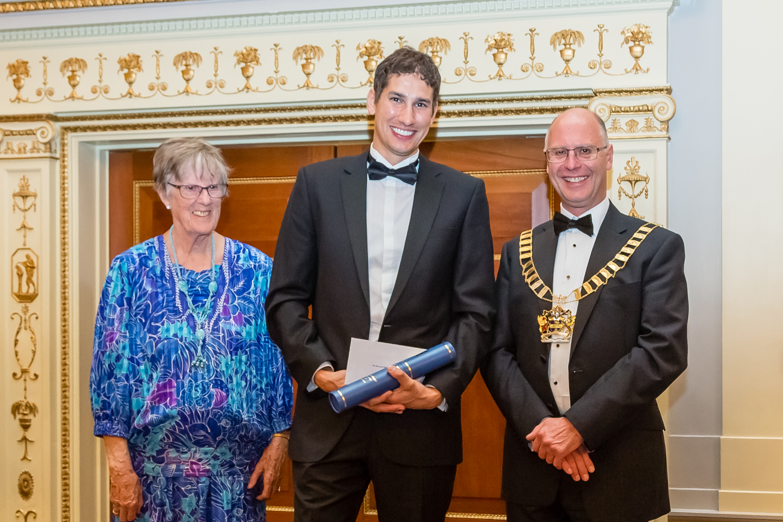 Matthew Foyle receiving the Baroness Platt of Writtle Award from Lady (Belinda) Gadsden (widow of Sir Peter Gadsden, founder Master of the Worshipful Company of Engineers) and Professor David Johnson, Master of the Worshipful Company of Engineers.  Photograph courtesy of Mark Whitter Photography.