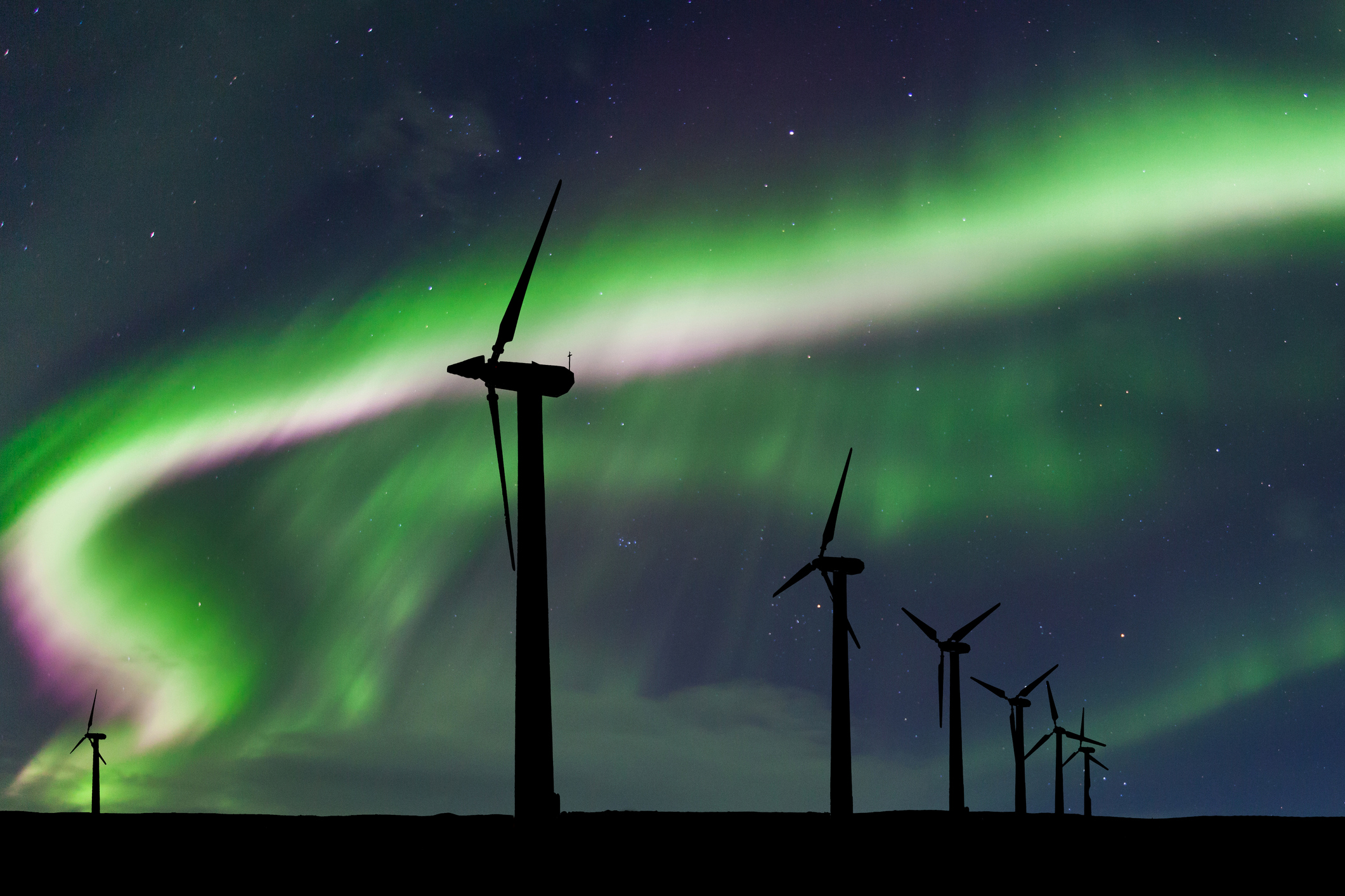 Wind turbines on the background of the Northern Lights