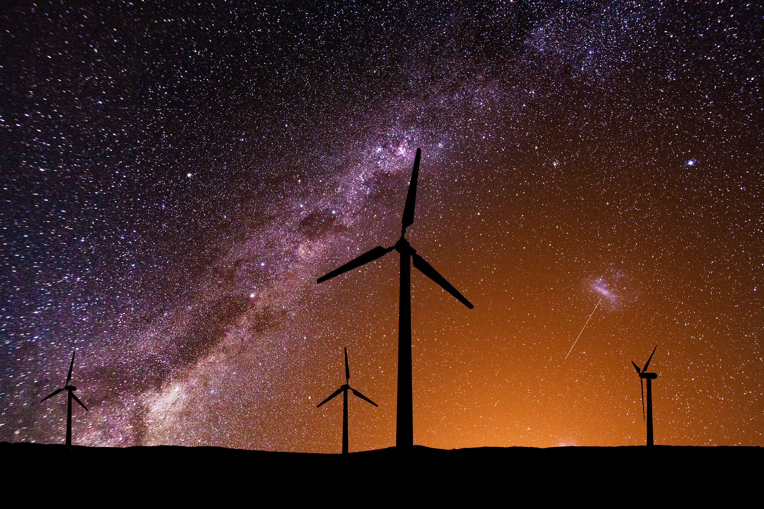 Wind turbines at night under the Milky Way