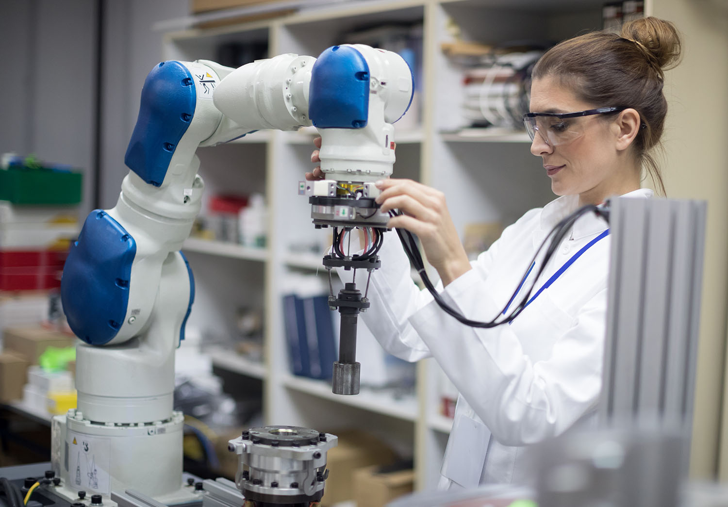 Woman engineer working on a robotic arm