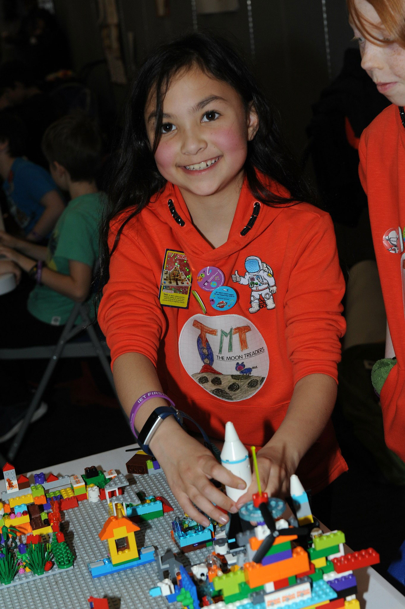 A young girl building with Lego
